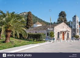 st nicholas church and palm trees in thassos island greece stock