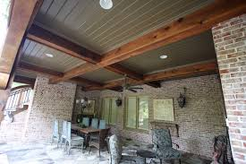 covered cedar porch with pergola fireplace arbor and slate floor