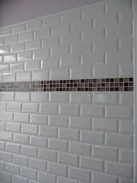 subway tile back splash in a glass mosaic tile flooring tumbled