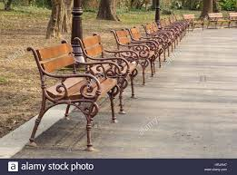 Wooden Park Bench Empty Wooden Park Benches With Metal Railing Stock Photo Royalty