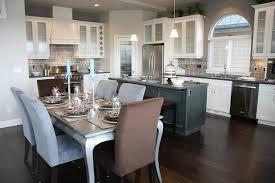 white backsplash dark cabinets stainless steel arc high single handle faucet white tile ceramic