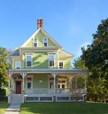 outstanding green exterior paint with front porch white trim lattice