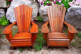 Wooden Patio Chairs by Two Solid Wood Patio Chairs And Natural Stone Landscaping Stock