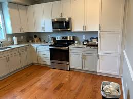 different color cabinets for kitchen is a three tone kitchen much