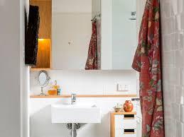 bathroom alcove tub beige tile integrated sink luxe luxury modern