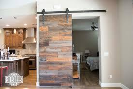 Reclaimed Wood Barn Doors by Industrial Orange Accent Hemlock Sliding Barn Door Porter Barn Wood