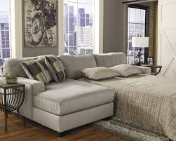 cream leather folding sectional sleeper sofa with gray linen