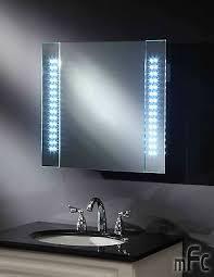 Led Illuminated Bathroom Mirror Cabinet by Led Illuminated Bathroom Mirror Cabinet Shaver Socket Sensor