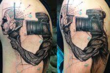 picture of small camera tattoo design