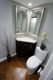 Corner Mirrors For Bathroom Wooden Floor With Silver Framed Corner Mirror And Black Vanity For