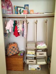 Baby Closets Interior Opened Baby Closet Organizers And Three Hanging Clothes