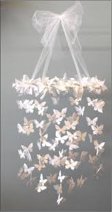 Handmade Chandelier by All You Need Is A Butterfly Punch Paper Ribbon And A Circle And