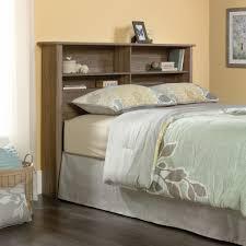 black wooden storage bed with black wooden headboard shelf plus