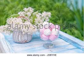 Round Glass Vase White And Pink Marshmallows In Round Glass Vase With A Basket Of