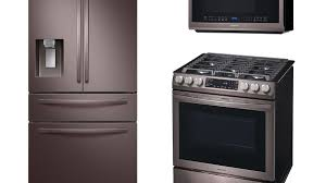 white kitchen cabinets with black slate appliances samsung shocks the appliance world with a slightly different