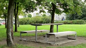 Old Park Benches Old Wet Wooden Tables And Benches In The Pouring Rain Lush Green