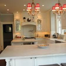 Candlelight Kitchen Cabinets Snowflake Shaker Candlelight Cabinetry With White Marble