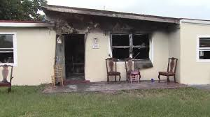 1 dog killed 2 escape in fire at west park home