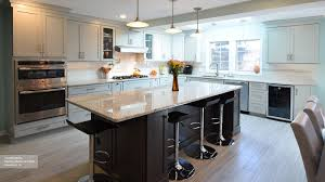 black and wood kitchen light grey kitchen cabinets with dark countertops