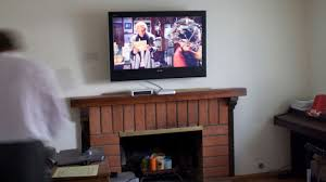 when setting up your home theater it s tempting to mount the tv above your fireplace this arrangement seems like a great use of space but it s actually