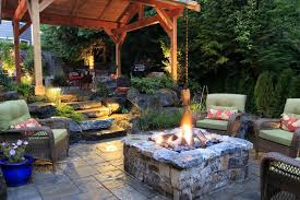 rustic patio with exterior stone floors by alderwood landscape
