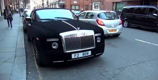 roll royce purple rolls royce phantom drophead wrapped in black velvet spotted in