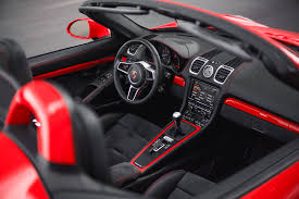 guards red porsche boxster spyder with color matched interior