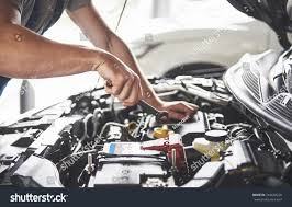 car engine service picture showing muscular car service worker stock photo 744678226