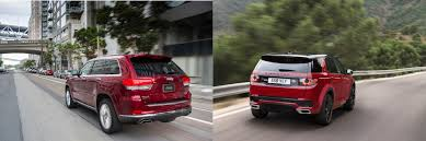 2017 land rover discovery sport trunk head to head 2016 jeep grand cherokee vs 2016 land rover