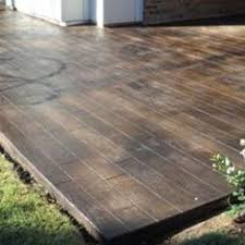 how to lay deck flooring on a concrete patio laying decking