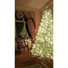 the pre lit iridescent pine tree with warm white lights