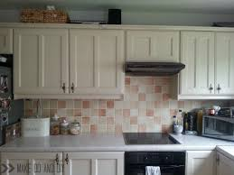 Kitchens With Backsplash Tiles by Painted Tile Backsplash Cover Those Ugly Tiles Make Do And Diy