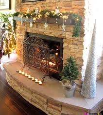rustic christmas themed mantel decoration with green garland and
