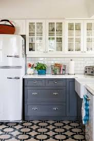 White And Gray Kitchen Cabinets by Sage Green Cabinets Marble Counters Subway Backsplash Brass