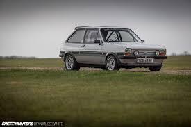 old subaru hatchback flying high in a ford with a subaru party out back speedhunters