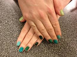 the beauty of life mani of the week green ombre nails with essie