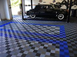 free flow self draining garage flooring racedeck free flow graphite royal blue and alloy garage with car lift