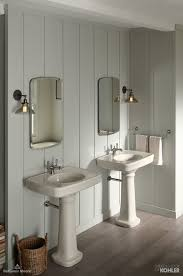 biscuit and pastel bathroom with dark wood floors featuring bancroft collection collaborationinfullcolor