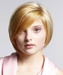 short hair with wispy front and sides this highlighted hairdo is tapered into the back with jagged