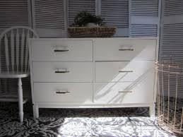 modern white dresser with champagne bronze entri ways