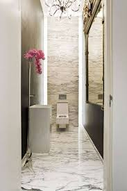 narrow bathroom ideas with marble floor and chandelier and ornate