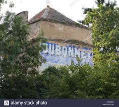 french advertising mural on wall of old house in burgundy france french advertising mural on wall of old house in burgundy france