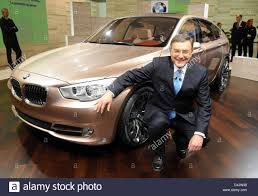 bmw ceo bmw ceo norbert reithofer poses with bmw s new concept 5 gran