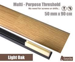 Laminate Flooring Transitions Light Oak Laminated Transition Threshold Strip 50mm X 90cm Multi