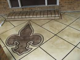 custom fleur de lis logo on front porch entryway by krete