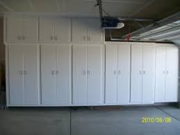 Garage Wall Cabinets Home Depot by Narrow Garage With White Many Doors Home Depot Garage Storage