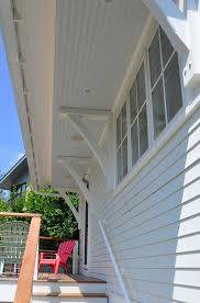 Beadboard Exterior - siding rafter tails and beadboard detailing enhance the