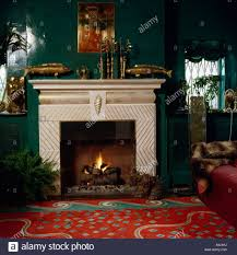 accessories magnificent dark green living room hd gallery dark accessories archaiccomely fireplace lighted fire in dark green livingroom patterned red carpet living room carpet