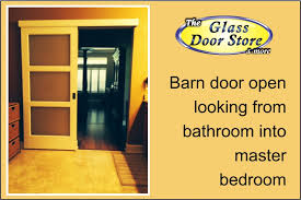 a privacy sliding glass barn door for a bathroom the glass door