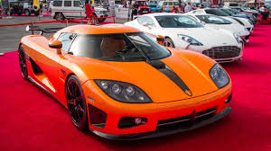 koenigsegg cc8s orange autotrader motor show highlights one 77 veyrons ccxr mansory